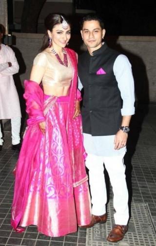 Soha Ali wears a Banarasi lehenga at her wedding reception.