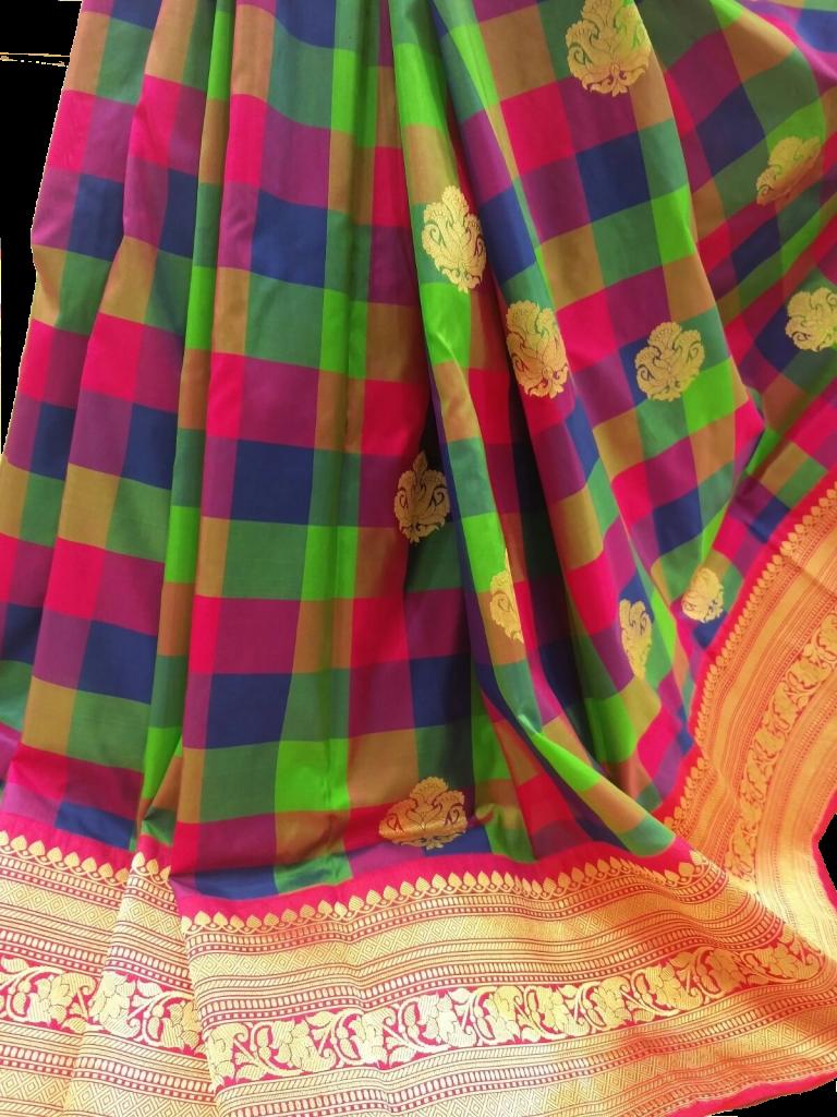 Stunning banarasi check pattern sari.